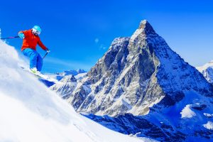 man-skiing-on-fresh-powder-snow