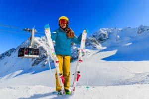 portrait-happy-young-girl-snow-ski